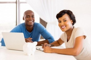 young african couple paying bills