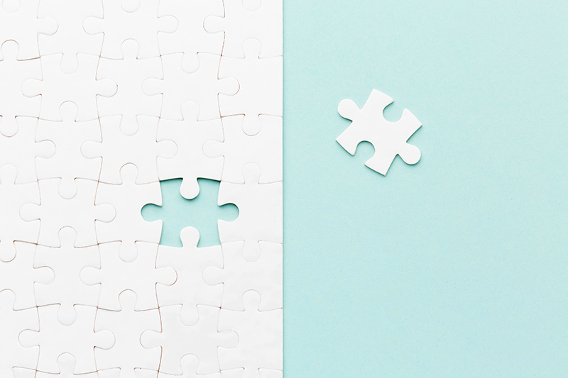 top-view-puzzle-with-one-piece-missing