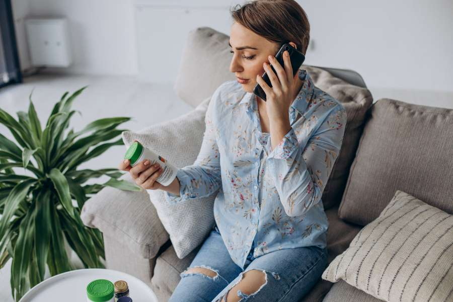 What kinds of new ADHD medications are available for adults - woman holding pill bottle on the phone