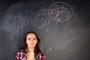 what is the best way to deal with emotional dysregulation - woman in front of blackboard